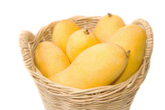 Closeup ripe mangoes in basket Royalty Free Stock Images