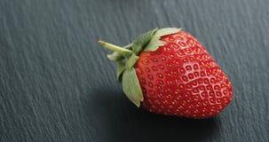 Closeup of ripe organic strawberries on slate background stock photos