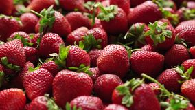 Closeup of ripe strawberries. Closeup of ripe sweet strawberries, sliding video stock video