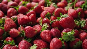 Closeup of ripe strawberries. Closeup of ripe sweet strawberries, sliding video stock footage