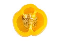 Closeup of a ripe yellow bell pepper cut in half Stock Photo