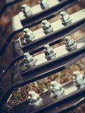 Closeup of ripper machinery rods with screws Royalty Free Stock Images