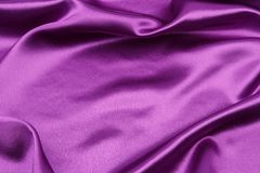 Purple silk fabric. Closeup of rippled purple silk fabric Stock Photos