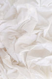 Closeup of rippled white silk fabric Royalty Free Stock Photos