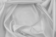 White silk. Closeup of rippled white silk fabric Royalty Free Stock Image