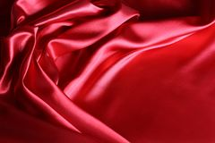 Red silk fabric. Closeup of ripples in red silk fabric Royalty Free Stock Photography
