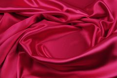 Red silk fabric. Closeup of ripples in red silk fabric Stock Photography
