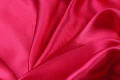 Red silk fabric. Closeup of ripples in red silk fabric Royalty Free Stock Photos