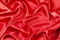 Red silk fabric. Closeup of ripples in red silk fabric Stock Images