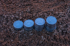 Closeup of a rising coins of silver coins depicting increasing bar graph. Stock Photo