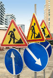 Closeup of road repair signs with building on background stock image