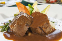 Closeup of roast beef meal in gravy stock photos