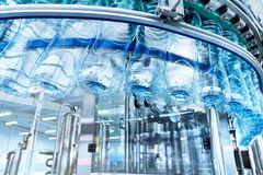 A closeup of a robotic mineral water production line. At a plant. Industrial background royalty free stock image