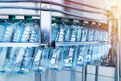 A closeup of a robotic mineral water production line. At a plant. Industrial background royalty free stock photo