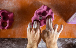 Closeup of rock climber`s hands gripping handhold Royalty Free Stock Images