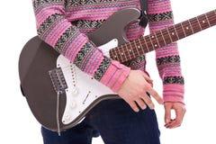 Closeup of a rock and roll guitarist Stock Photos