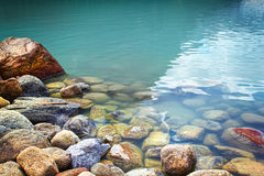 Closeup of rocks in water at lake Louise Royalty Free Stock Images