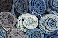 Closeup rolled of blue jeans pants, dark blue denim trousers Royalty Free Stock Photos