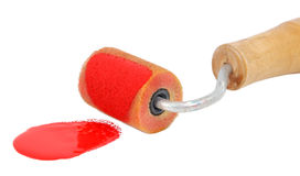 Closeup of roller applying bright red paint Stock Photography