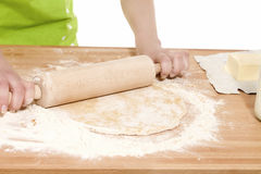 Closeup of a rolling pin on dough Stock Photography