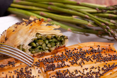 Closeup Of Rolls Of Asparagus In Crust stock photo