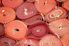 Closeup of Rolls of red mat Royalty Free Stock Photos