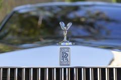 Closeup of Rolls Royce logo on car stock photography
