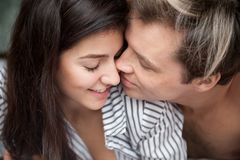 Closeup of romantic couple tender gentle touching face to face. Close up view of beautiful romantic couple tender gentle touch face to face, young men getting Stock Photos
