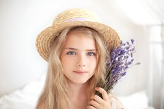Free Closeup Romantic Portrait Charming Little Blond Girl In A Straw Hat Holds A Bouquet Of Lavender. Summer Flowers, Aromatherapy. An Stock Photography - 158447062