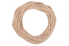 Closeup of rough brown braided rope coiled in the form of ring. Concept equipment, strength, sport, fitness, exercise, workout, stock photography