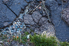Closeup of really rough cracked rocky grunge asphalt texture. Royalty Free Stock Photography
