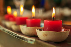 Closeup Row of Red Candles. A closeup view of red candles with bokeh Royalty Free Stock Photos