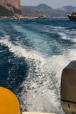 Closeup of Rubber Boat& x27;s Stern with Motor and Water& x27;s Suds Stock Images
