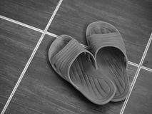 CLOSEUP OF RUBBER SANDAL ON FLOOR Royalty Free Stock Images