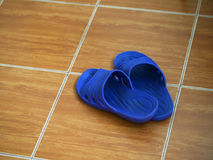CLOSEUP OF RUBBER SANDAL ON FLOOR Royalty Free Stock Photo