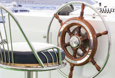 Yacht rudder. Closeup of rudder and chair in a luxury boat Stock Photo