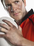 Closeup Of Rugby Player Holding Ball Stock Image