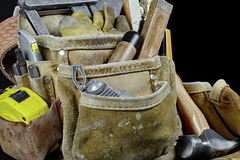 Closeup of rugged worn leather carpenters work bags with constru Stock Photos