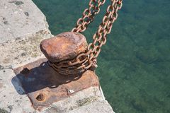 Closeup of Run-Down iron berth with chain Royalty Free Stock Images