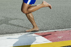 Closeup of a runners feet barefoot running Stock Photo