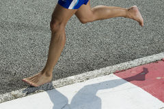 Closeup of a runners feet barefoot running Royalty Free Stock Image
