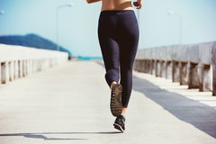 Closeup running girl sea pier Royalty Free Stock Image