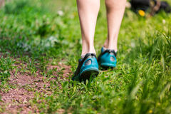 Closeup of running shoes of woman barefoot. Stock Photo