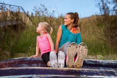 Closeup of running shoes worn by mother and child Stock Images