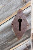 Closeup of a rustic empty lock on a wooden door Stock Photos