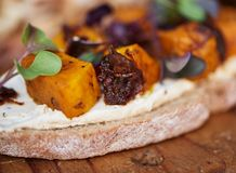 Delicious butternut and beet open faced sandwich on a board Stock Photo