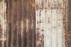 Closeup of a rusty and corrugated wall. Close-up of a rusty and corrugated iron metal construction site wall texture background stock image