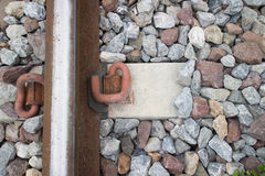 Closeup of rusty railroad. Close-Up of a Rail, a Rail Line, and a Concrete Sleeper Royalty Free Stock Photography