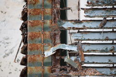 Closeup of a rusty and rotted metal facing. Sign of lapse Royalty Free Stock Photo