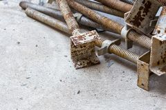 Rusty screw scaffold. Closeup rusty screw scaffold on floor concrete in construction site Royalty Free Stock Photography